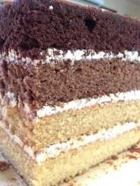 Uncovered MInecraft Diamond Ore cake: four layer cake - choc, choc caramel, caramel and vanilla. Vanilla swiss meringue buttercream with layer of Cadbury Marvellous Creations: Jelly Popping Candy Beanies